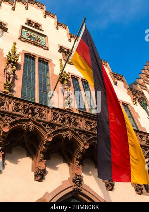 German flag outside the reconstructed Romer building, the ancient town hall of Frankfurt am Main, Hesse, Germany. - Stock Photo