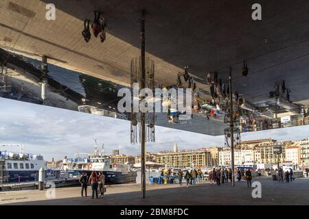 The L'Ombriere by Norman Foster at Marseille Old Port. It is polished steel canopy that reflects visitors walking underneath the pavilion - Stock Photo