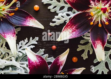 Lillies with Dusty Miller, Carnelian and Red Jasper on Brown Background - Stock Photo
