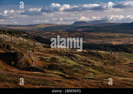 Distant Cadair Idris from the summit of Crimpiau in autumn, Snowdonia National Park, North Wales, UK - Stock Photo