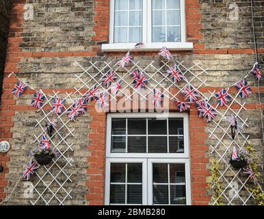 London UK Friday 8 May VE Day ,people putting up flags outside their houses in Sutton South London to celebrate the 75th anniversary of the end of the war.Paul Quezada-Neiman/Alamy Live News - Stock Photo