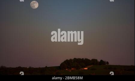Full Flower Super Moon rising over Wirksworth, Derbyshire Dales, Peak District, UK - Stock Photo
