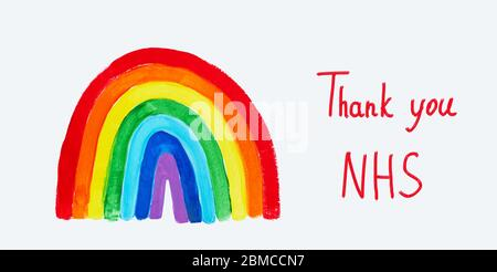 Thank to NHS lettering. Childrens hand drawing rainbow on paper. Greating card for nurses. - Stock Photo