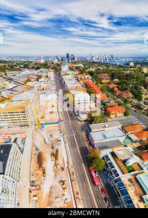 New Sydney Metro train station in Crows Nest suburb of Lower North shore - aerial vertical panorama towards city CBD and Harbour. - Stock Photo
