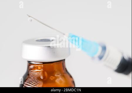 Medicine bottle for injection, medical glass vials and syringe for vaccination on white background . - Stock Photo