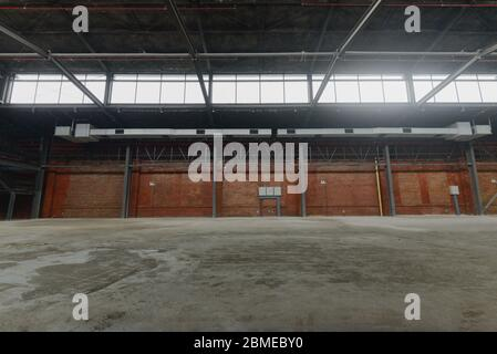 Unmanned, industrial style old warehouse building space. - Stock Photo