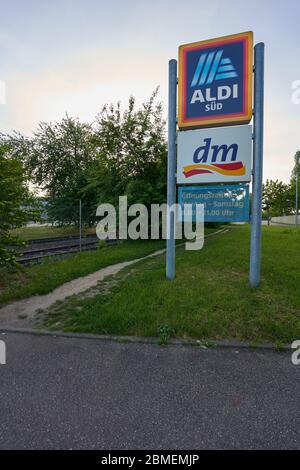 Altbach, Germany - Mai 08, 2020: Logo of the company Aldi and Dm Market. Information about opening times. Altbach, Germany.