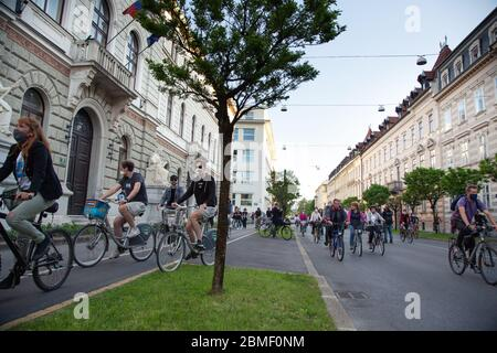 Ljubljana, Slovenia, May 8, 2020: Protesters on bicycles pass the presidential palace during an anti-government protest amid the coronavirus crisis. Following whistleblower's revelations of corruption in the government of Janez Janša and accusations of its undemocratic rule over five thousand people rode bicycles around government buildings in sign of protest. - Stock Photo