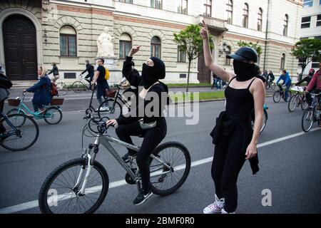 Ljubljana, Slovenia, May 8, 2020: Protesters wearing face masks as preventive measure shout and gesture while riding their bicycles during an anti-government protest amid the coronavirus crisis. Following whistleblower's revelations of corruption in the government of Janez Janša and accusations of its undemocratic rule over five thousand people rode bicycles around government buildings in sign of protest. - Stock Photo