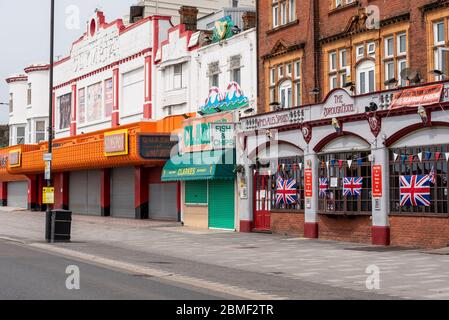 Closed businesses on sunny day in Southend on VE Day Bank Holiday during COVID-19 Coronavirus pandemic lockdown period. Shut amusement arcade. British - Stock Photo