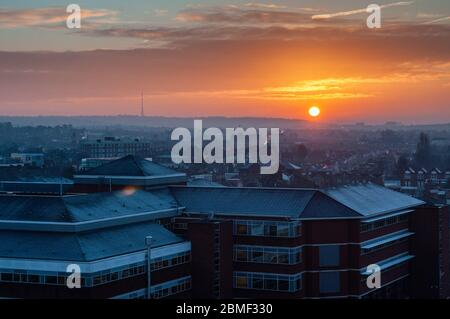 London, England, UK - February 8, 2013: The sun rises over St George's Hospital and the suburban housing of Tooting in South London. - Stock Photo