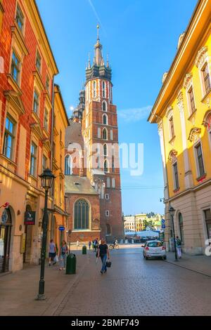 Krakow, Poland - June 18, 2019: Famous shopping street Florianska in the old part of town, leading to St. Mary's Basilica and Rynek main square - Stock Photo