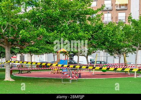 Park sealed with plastic tape so that children cannot play to avoid the spread of the coronavirus in the quarantine state - Stock Photo