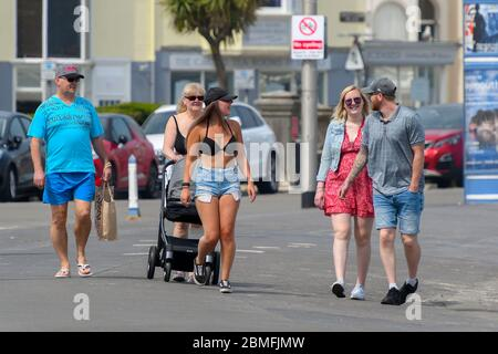 Weymouth, Dorset, UK.  9th May 2020.  UK Weather:  A family exercising on the seafront on a day of scorching hot sunshine at the seaside resort of Weymouth in Dorset during the coronavirus lockdown.  Picture Credit: Graham Hunt/Alamy Live News