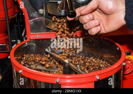 Antique coffee grinder with coffee beans, various types: dark black, brown, green specialty from diverse countries. Ethiopia, Maroc, Turkey. Coffee ba - Stock Photo
