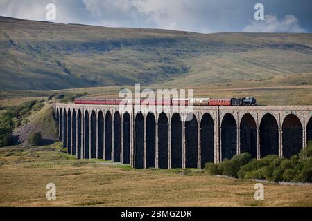 Steam locomotive 61994 The Great Marquess crossing Ribblehead viaduct on the settle to Carlisle line with the West coast railways fellsman train
