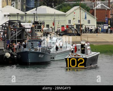 AJAXNETPHOTO. 25TH AUGUST, 2016. PORTSMOUTH, ENGLAND. - COASTAL FORCES 100TH ANNIVERSARY - RESTORED SECOND WORLD WAR COASTAL FORCES 'LITTLE SHIPS' FLOTILLA INCLUDING HARBOUR DEFENCE MOTOR LAUNCH MEDUSA, MGB 81, HSL 102 MOORING UP AT THE PNBPT BERTH OPPOSITE HMS WARRIOR. PHOTO:JONATHAN EASTLAND/AJAXREF:D162508_6194 - Stock Photo