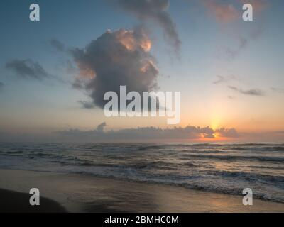 Large Gray Cloud on the Sky During Beach Sunrise - Stock Photo
