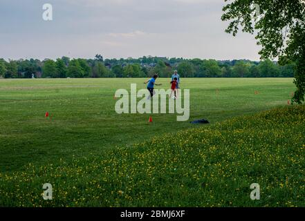 Harrogate, North Yorkshire, UK, 9th May 2020.  A family plays football in the empty Stray park in the centre of the town. Credit: Ernesto Rogata/Alamy Live News. - Stock Photo