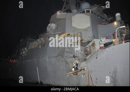 Damage alongside the starboard mid-section of the U.S. Navy Arleigh Burke-Class guided-missile destroyer USS Porter following a collision with a Japanese owned bulk oil tanker M/V Otowasan August 12, 2012 in the Strait of Hormuz. No personnel on either vessel were reported injured in the accident. - Stock Photo