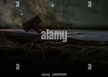 Night sky above the silver clouds. Telescope watching the Milky Way in the spring visible from Teide National Park near Observatory. Jupiter is sparkl - Stock Photo