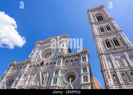 Florence, Italy - August 16, 2019: Cathedral Santa Maria Del Fiore and Giotto's Campanile on Piazza del Duomo in Florence