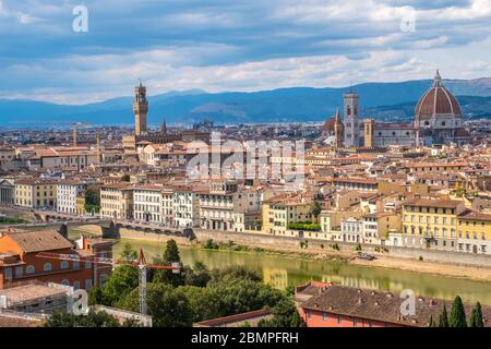 Florence, Italy - August 16, 2019: View of Florence Skyline with Ponte Vecchio and Santa Maria del Fiore Duomo, Tuscany, Italy