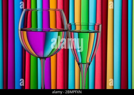 Glasses of water against a stripped background. Water in refracting light. Still life