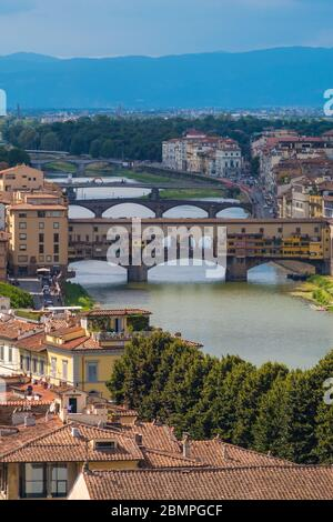 Florence, Italy - August 16, 2019: Florence cityscape and bridges on Arno River in Tuscany, Italy