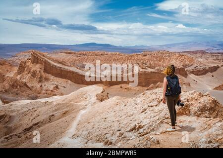 Female traveler exploring the Valley of the Moon (Spanish: Valle de La Luna ) in the Atacama Desert, Chile, South America. - Stock Photo