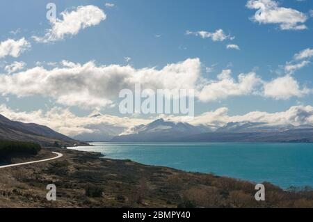 Epic landscape with turquoise cold waters of Pukaki lake and mountain range on the background. Winter travel New Zealand nature landscape