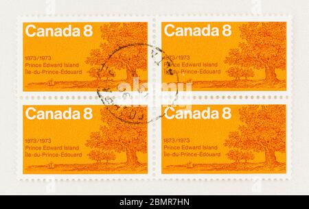SEATTLE WASHINGTON - May 10, 2020:  Orange Canadian stamp commemorating centenary of PEI entry into Confederation. Scott # 618 - Stock Photo