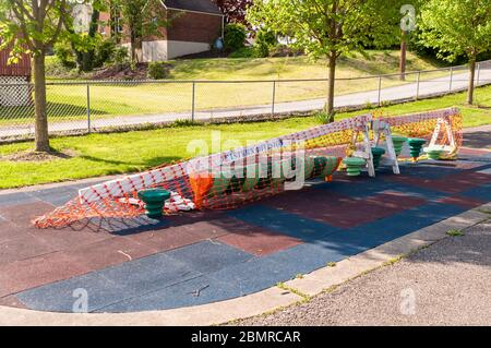 Playground equipment closed and roped off due to the Covid 19 pandemic at the Swisshelm Park playground, Pittsburgh, Pennsylvania, USA - Stock Photo