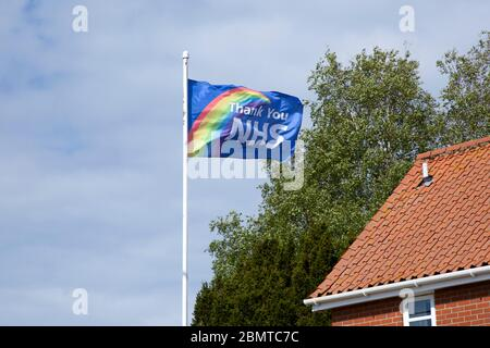 Thank You NHS flag flying in breeze, UK during 2020 Coronavirus Covid-19 crisis - Stock Photo