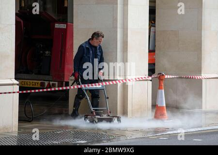 11.05.20. Coronavirus Pandemic, Bath, Somerset.  A worker cleans the streets in Bath, Somerset, as the UK government lockdown restrictions start to be - Stock Photo