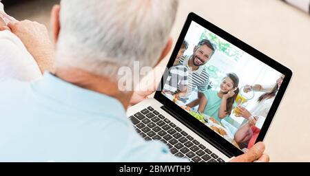 Senior man having video call on laptop. - Stock Photo