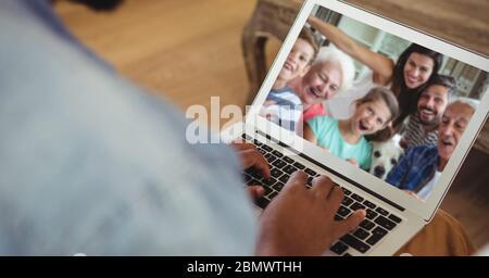 Family having video call on laptop - Stock Photo