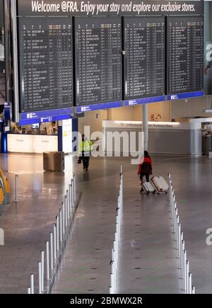11 May 2020, Hessen, Frankfurt/Main: Terminal 1 of Frankfurt Airport is almost deserted at the Lufthansa check-in counters. Lufthansa has got into a massive financial imbalance as a result of the worldwide corona pandemic. Photo: Boris Roessler/dpa