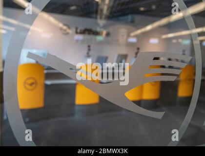 11 May 2020, Hessen, Frankfurt/Main: The logo of the German airline Lufthansa can be seen on the deserted First Class ticket sales area at Frankfurt Airport. Lufthansa has got into a massive financial imbalance due to the worldwide corona pandemic. Photo: Boris Roessler/dpa