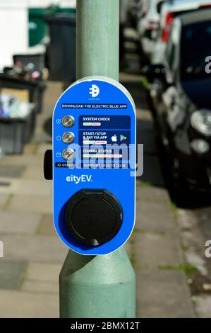 Public electronic car charging point on lamppost in street