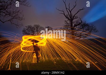fire spinning with steel wool - Stock Photo