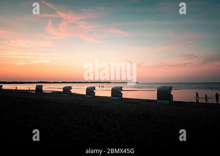 Strandkörbe an der Ostsee zum Sonnenuntergang - Stock Photo