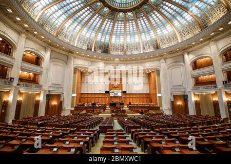 Bucharest, Romania - May 11, 2020: Romanian members of parliament attend a Parliament's session in the Chamber of Deputies hall of the Palace of Parli - Stock Photo