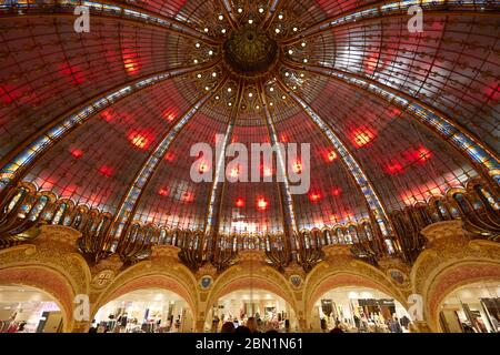 PARIS - NOVEMBER 6, 2019: Galeries Lafayette dome interior with red lights in Paris