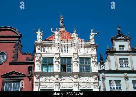 Gdansk Poland, The decorative attic of the Golden Tenement House is complemented by statues representing the four cardinal virtues - Prudence, Justice - Stock Photo
