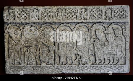 Screen slabs from the Church of St. Nediljica in Zadar, 11th century (copy). Croatia. Left : Shepherds watch the 'First Bath' (under the Star of Bethlehem). Right: Mary, seated on a folding chair, having Jesus on her knees, welcomes the Magi (wearing phrygian caps). Museum of Croatian Archaeological Monuments. Split. Croatia. - Stock Photo