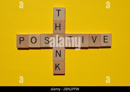 Think Positive, crossword isolated on bright yellow background - Stock Photo