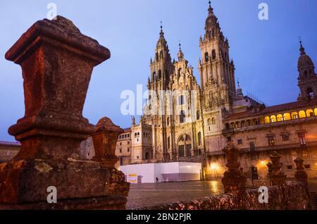 Santiago de Compostela, A Coruña province, Galicia, Spain - February 12th, 2020 : Illuminated Baroque facade of the cathedral in the Obradoiro square.