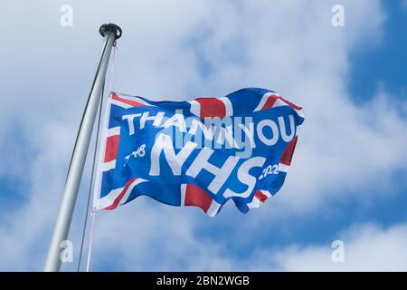 Putney London, UK. 12th May, 2020. Coronavirus Lock Down. A flag bearing the message 'Thank You NHS 'as a show of support for the NHS (National Health Service) founded in 1948 and all essential workers during the Coronavirus pandemic lockdown. Credit: amer ghazzal/Alamy Live News - Stock Photo