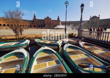 Seville, Spain: Dec 23, 2019: In Plaza de Espana boat hire, tourist attraction go on row boat around the water of Guadalquivir river. Sevilla, Spain